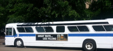 old NYC bus with old Miller Lite ad